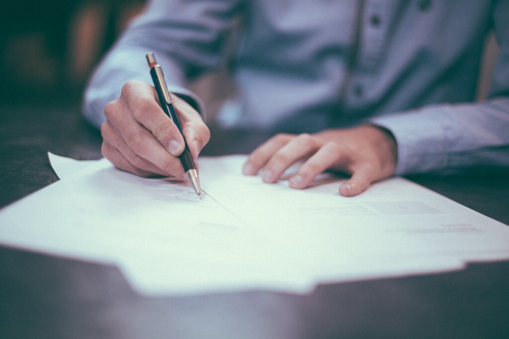 Applying for a job - signing contract with pen